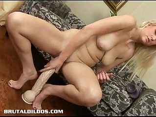 Armani stretches her wet pussy out with massive dildo
