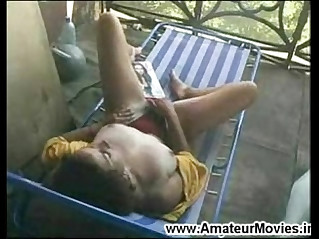Sexy horny milf masturbating on terrace